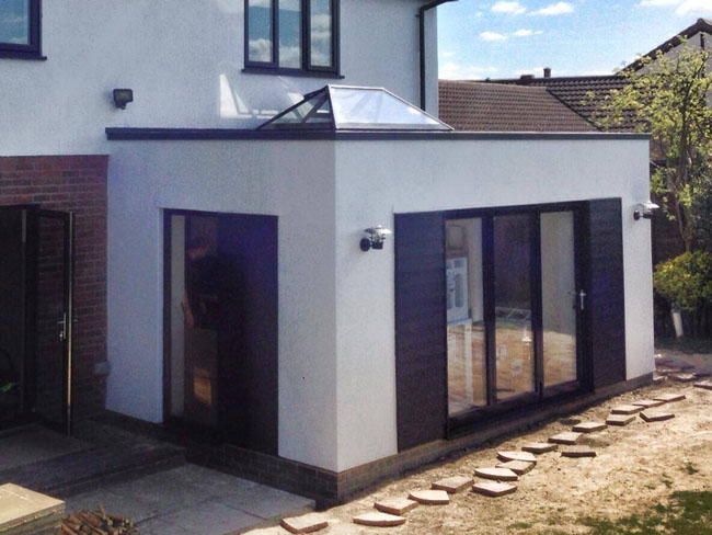 Rear extension to kitchen featuring roof lantern, aluminium windows and bi-fold doors.